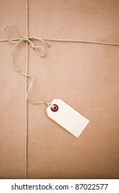 Brown paper parcel with a blank tag and copy space