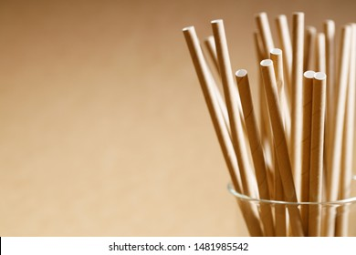 Brown paper straws in glass, Sustainable lifestyle concept
