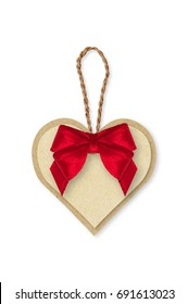 Brown Paper tag, rope and red ribbon bow on white background. Background and texture. Paper heart.