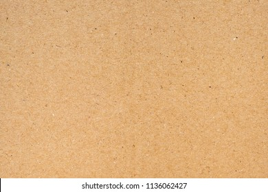 Brown paper texture background or cardboard surface from a paper box for packing.