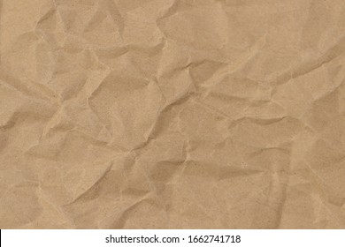 Brown paper with wrinkles texture background