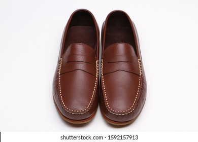 Brown penny loafer shoes with shoe  isolate on white background