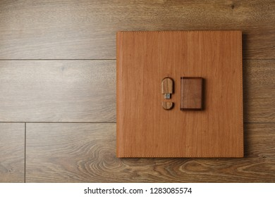 brown photo book with  leather cover.  stylish wedding photo album. Wedding photoalbum. photo book and flash drive in the box.