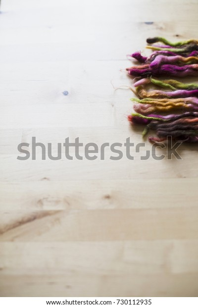 Brown, pink, yellow, orange and green threads.