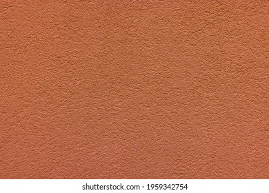 Brown plaster facade texture background. External facade of the building, plaster with clear texture.