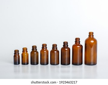 Brown plastic, glass bottle of different sizes.Packaging for cosmetics, oils and medical products. The Bottle template. Aerosol