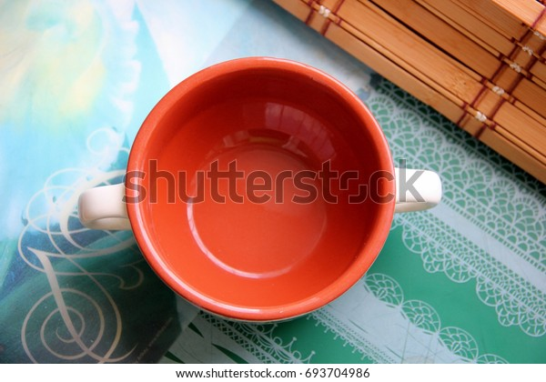 brown-porcelain-cup-top-view-600w-693704