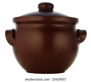 brown pot from heatproof ceramics with a spoon