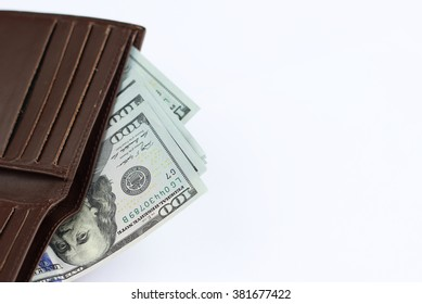 Brown purse with dollars on a white background