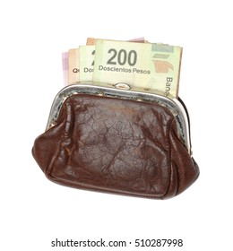 Brown purse with Mexican pesos isolated on white background.