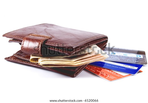 Brown purse, money and credit cards on white background