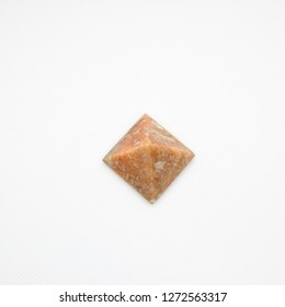 brown pyramid and white background