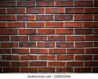 Brown and red brick wall. Brick background