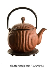 brown ribbed cast iron traditional japanese teapot (tetsubin) on a stand, isolated on white;