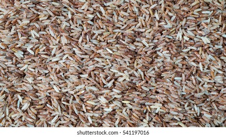 Brown rice background texture, Red rice background, Brown rice have Vitamin B2 , Brown rice is rich in Vitamin B2 helps prevent canker sore