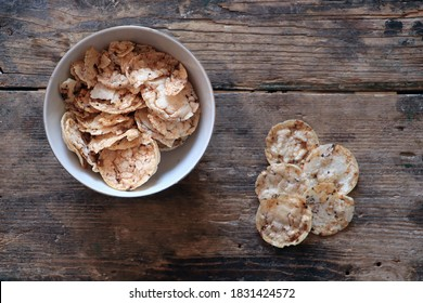 Brown rice chips with chia and quinoa seeds , healthy food concept