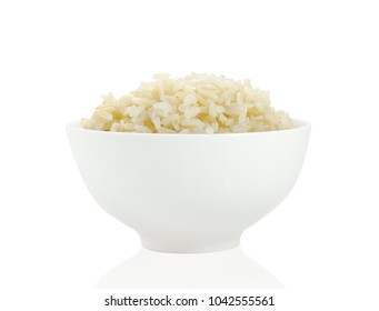 brown rice isolated with bowl on white background