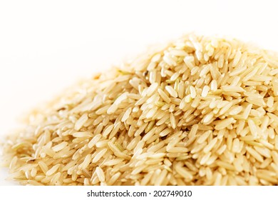 Brown rice paddy isolated on white.