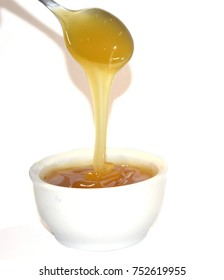 Brown Rice Syrup, with a spoon white background