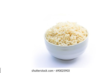 Brown rice in white bowl on a white background