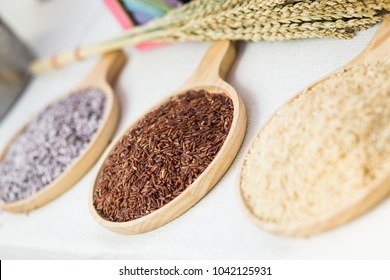 Brown rice. It is whole grain rice, with the inedible outer hull removed; white rice is the same grain with the hull, bran layer and cereal germ removed. Red, gold and black rice.