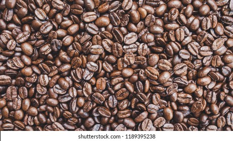 Brown roasted coffee beans background.