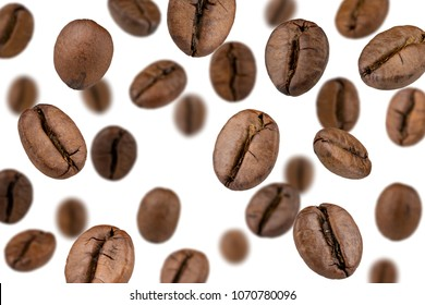 Brown roasted coffee beans falling , Represent breakfast, energy, freshness or great aroma,white background and bright wallpaper concept.close-up