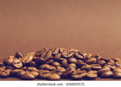 Brown roasted coffee beans on dark background. Espresso dark, aroma, black caffeine drink. copy space.