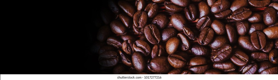 Brown roasted coffee beans, seed on red background. Espresso dark, aroma, black caffeine drink. Closeup isolated energy mocha, cappuccino ingredient.