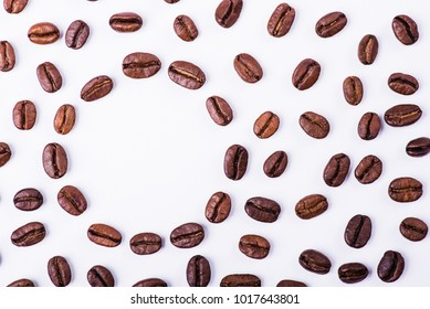 Brown roasted coffee beans, seed on white background. Espresso dark, aroma, black caffeine drink. Closeup isolated energy mocha, cappuccino ingredient.