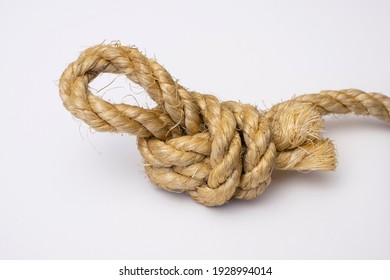 Brown rope is lying on a white background