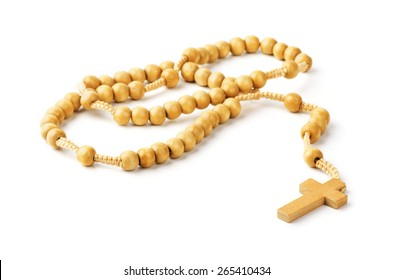 Brown rosary on a white background