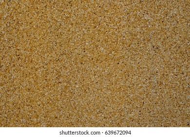 Brown rough texture surface of exposed aggregate finish, Ground stone washed floor, made of small sand stone in light brown color