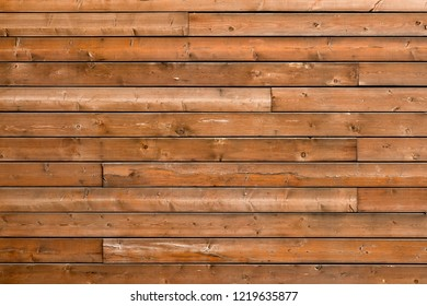 Brown rustic wooden texture background. Facade of a log house, copy space. Wooden texture background Wall of blockhouse