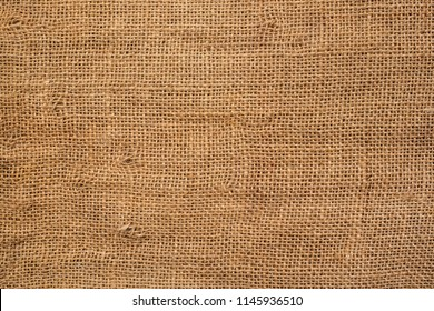 Brown sackcloth texture. or Background of Natural Brown Fabric Sack weaving is a bag. For packing