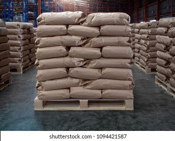 Brown sacks on wooden pallet store in industrial warehouse.