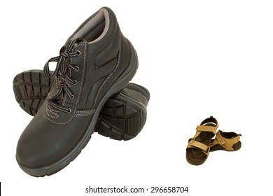 Brown safety shoe and slippers separated and isolated on white
