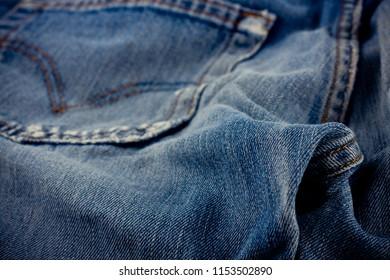 brown seam denim  and old blue jeans denim texture close up
