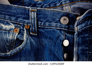 brown seam denim and silver button jeans  and on old blue jeans denim texture close up