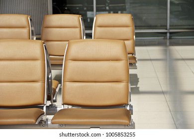 Brown seats in airport waiting area for departure flight