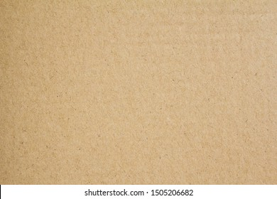 Brown sheet of craft cardboard paper texture background.