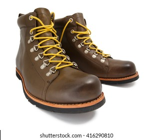 Brown shoes with yellow laces on white