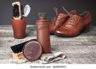 Brown shoeshine and cleaning brush for shoes protects