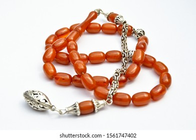 Brown and silver beads sequenced, short rosary, tespih tesbih, an important accessory for Turkish culture, isolated on white background.
