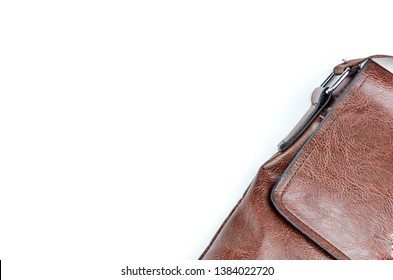 Brown sling bag on white background. Selective focus.