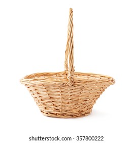 Brown small wicker basket isolated over the white background