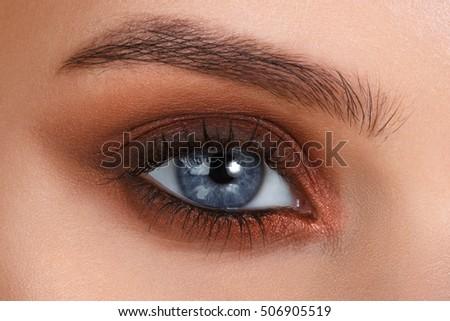 Blue eyes. Eye makeup. Beautiful eyes make-up. Holiday