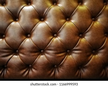 The brown sofa cover by leatherette. Interior decoration for loft style.
