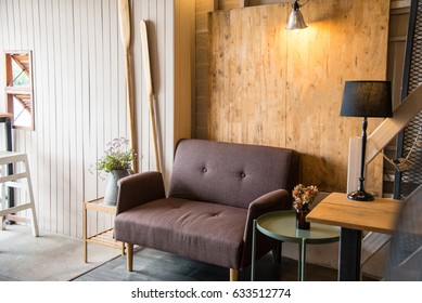 A brown sofa with wood background for relaxing