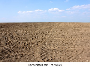 brown soil agriculture land and blue sky